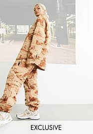 Collusion Unisex quilted joggers co-ord in skate print-Orange