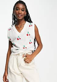 Liquorish V neck knitted vest with cherry embroidery in white