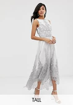 premium lace midi dress with dip hem in white