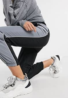 joggers with contrasting side panel in black