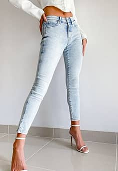 Calvin Klein high rise mid rise skinny jeans in bleached blue