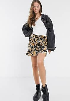 Urban Bliss tie front mini skirt with frill hem in black floral