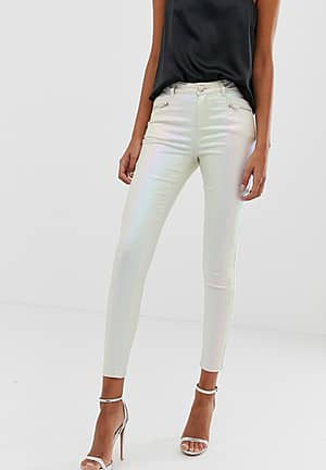 coated skinny jeans in pearlescent cream