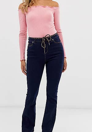 rinse wash kick flare jeans with rope belt detail and raw hem