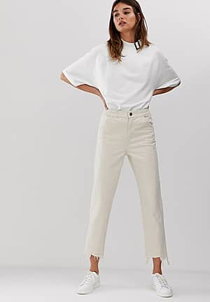 cropped raw edge jeans with seam detail
