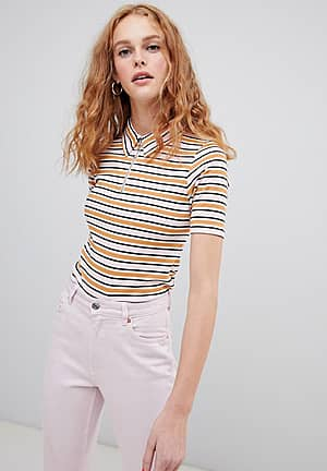polo top with collar and zip detail in retro stripe