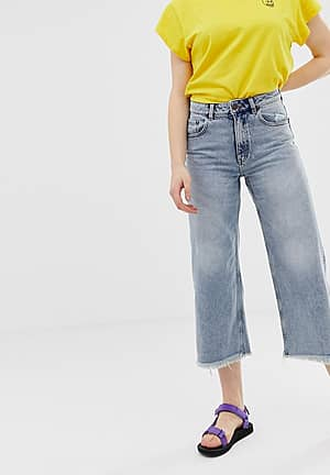 organic cotton high rise wide leg jeans with raw hem